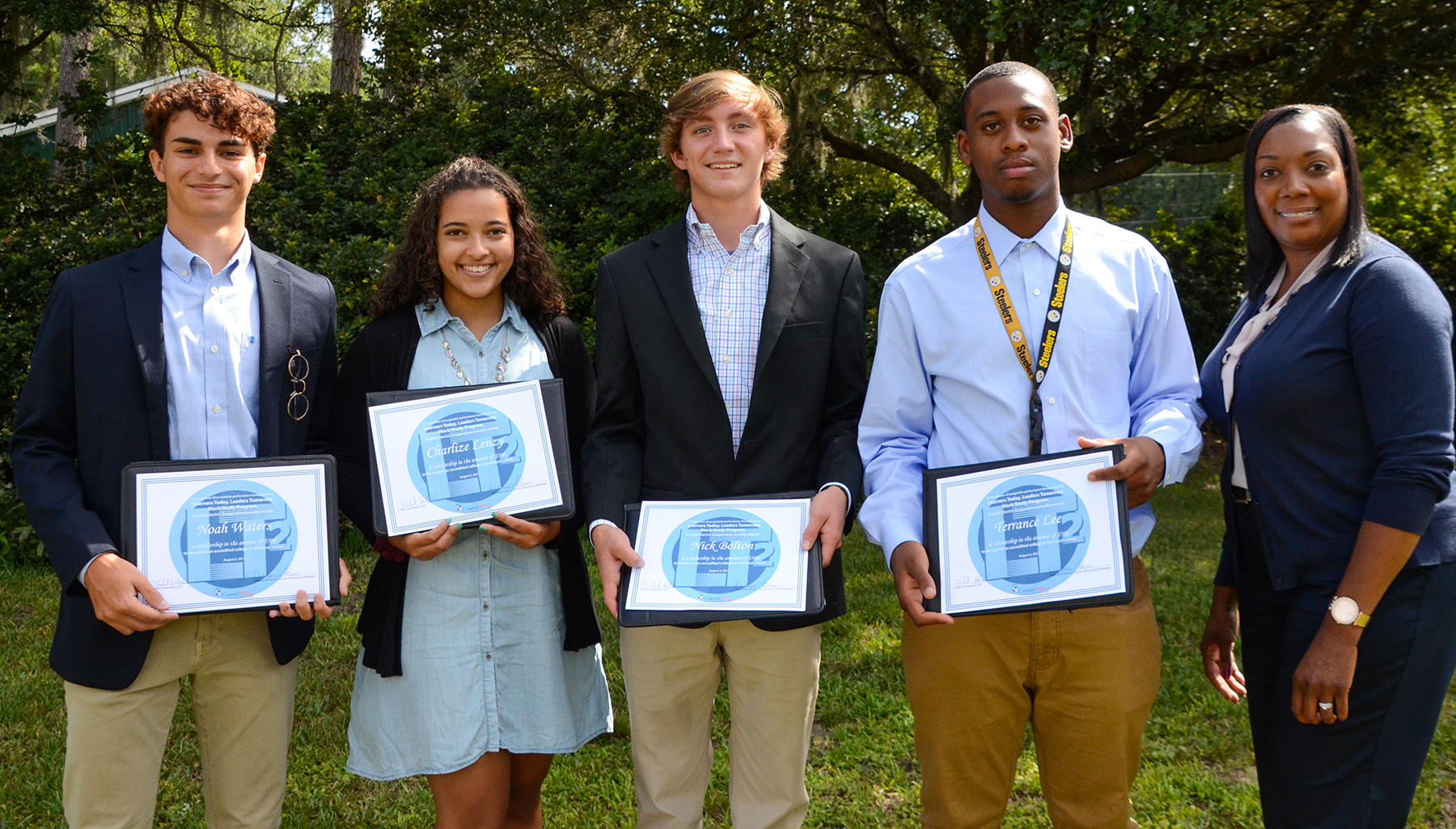 (From left) Noah Waters, Charlize Lenzy, Nick Bolton and Terrance Lee were each awarded $500 scholarships upon completion of their 2017 work-study program by Human Resources Manager Daphanie Harris.
